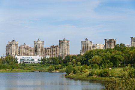 Modern residential complex is not on the lake and near the park.