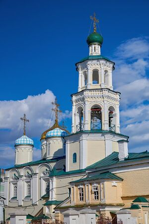 The bell tower of the old Orthodox Christian Cathedral in Kazan. Religion, faith in God. Tourism and travel, viewing of historical sights.