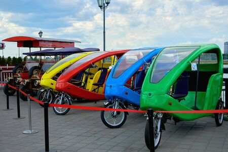Russia, Kazan June 2019. Three-wheeled vehicles and antique cars for sightseeing tours.
