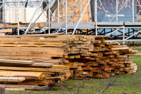 Wooden planks, lumber. Pine natural wooden boards on the site. Outdoor boards. Imagens