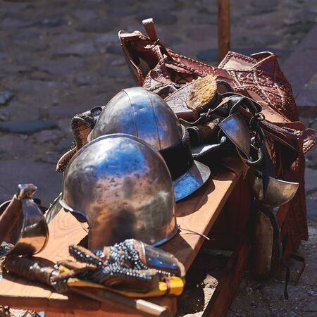 Vintage knight medieval suit of armor. Metal helmets to protect the warrior. Stock Photo