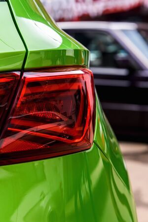 A fragment of the car's rear light in close-up. Modern design of the car's rear light.