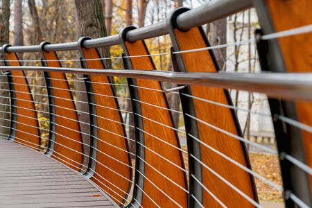 Suspended wooden bridge across the Park. Eco-friendly path in the Park for walking.