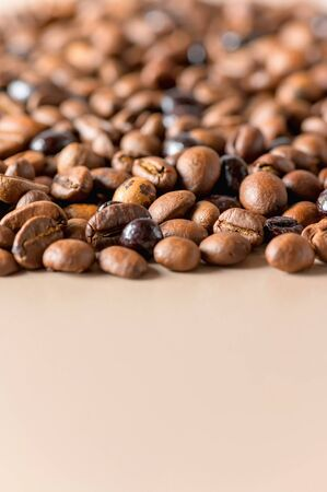 Coffee beans high quality textures background with copy space. Roasted coffee beans. A mix of different types of roasted coffee beans in the background.