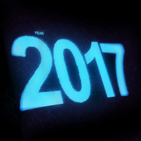 led display: happy new year 2017 on scratched led display bokeh pixel
