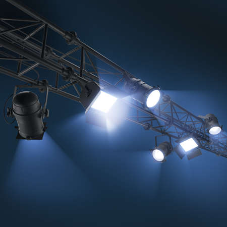 dramatics: 3d lighting spotlights, hanging floodlight or soffits on dark blue background Stock Photo