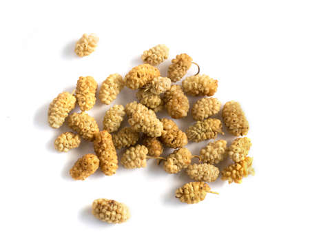 Dry white mulberry top view. Photo of dried sweet berries with natural light from the window