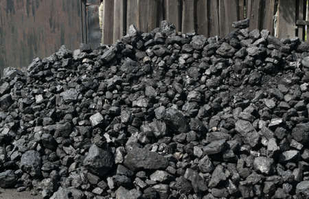 Pile of natural black hard coal for texture background. Best grade of metallurgical anthracite coals often referred to as stone coal and black diamond coal