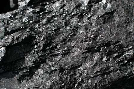 The surface of natural black hard coal for texture background. Best grade of metallurgical anthracite coals often referred to as stone coal and black diamond coal