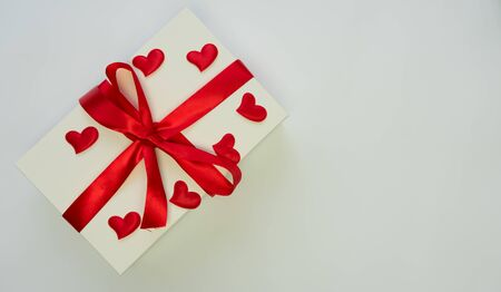 White box, red hearts and red ribbon on white backgraund, isolated, valentines day Stock Photo