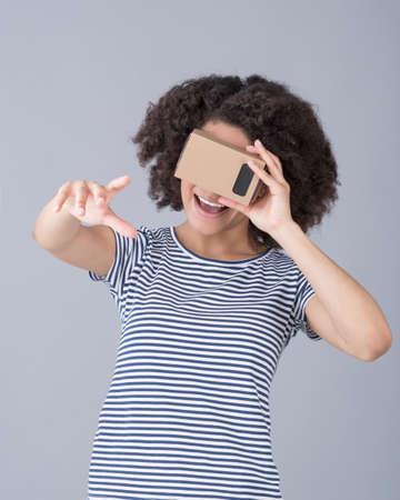 simulator: Girl using virtual reality device cardboard