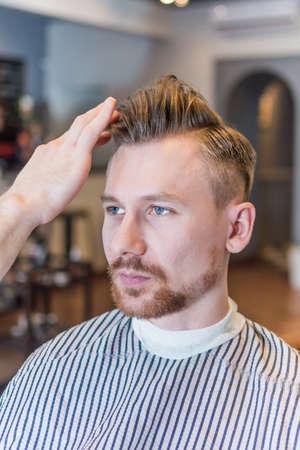 barbershop: Portrait of man in barbershop after haircut