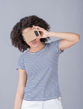 simulator: Girl using virtual reality device cardboard vr Stock Photo