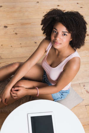 african american woman: Beautiful African american young woman at home