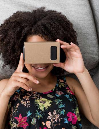 simulator: Young woman using virtual reality device cardboard vr Stock Photo