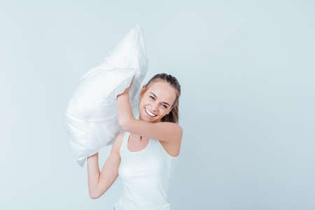 nice smile: Beautiful girl with a nice smile posing with a pillow