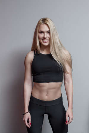 sports clothing: Portrait of a blonde woman wearing sports clothing in gym