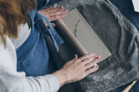 ceramicist: Ceramic artist working on a clay, small workshop