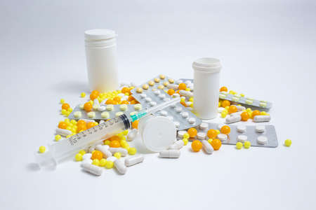 Prevention, cure of influenza, coronavirus. colorful pills, capsules on white