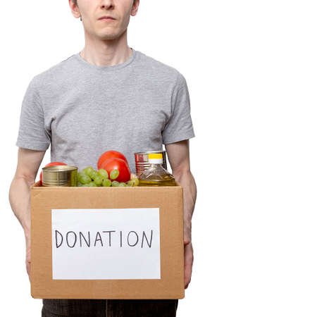 caucasian courier worker, volunteer holding grocery food in carton donation box Stok Fotoğraf