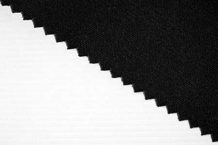 embossed paper: Striped embossed paper and fabric. White and black background. textile and wallpaper texture.