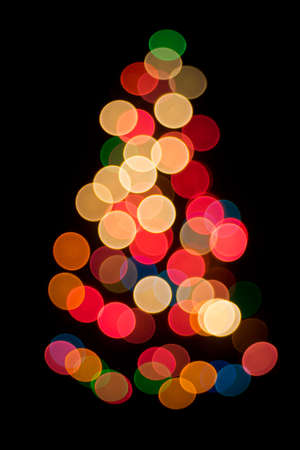 black background: Decorative multicolour bokeh on the Christmas tree