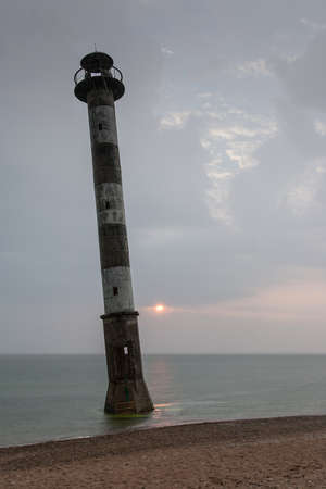 awry: Skew lighthouse in the Baltic Sea. Stormy night on the beach. Kiipsaar, Harilaid, Saaremaa, Estonia, Europe.
