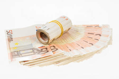 Rolled up euros with rubber on the fifty euro banknotes fan. Money bunch stack