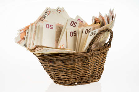pile of money: Fifty euro banknotes pile. Money bunch stack. Bill and brown basket on white background. Euros heap