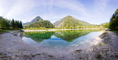 Crystal clear blue water, lake and mountains.  Panorama of wild landscape, natural environment. Julian Alps, Triglav National Park in Slovenia.