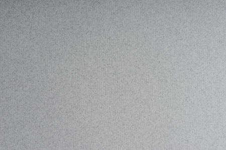 mirk: Dark gray rippled paper texture background.