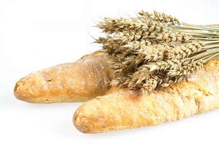 Wheat bunch and baguette isolated on white background. Grain bouquet and bread. Golden spikelets. Food, bakery concept