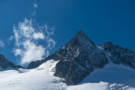 Mountains and peaks landscape. Stubaier Gletscher covered with glaciers and snow, natural environment. Hiking in the Stubai Alps. Ski resort in Tirol, Austria, Europe