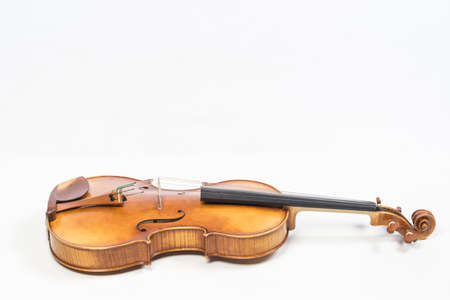 The old fiddle, isolated on white background. Viola, Instrument for classical music. Stock Photo