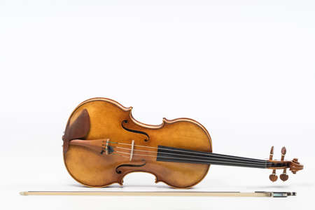 The old fiddle, isolated on white background. Viola, Instrument for classical music. Standard-Bild