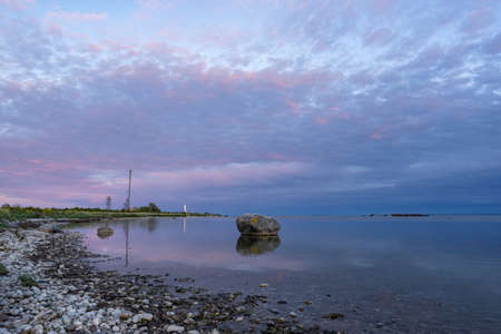 Skew lighthouse in the Baltic Sea. Shore, evening light, sunset, moon and architecture concept. Harilaid, small island in Estonia, Europe. Stock Photo - 133382735