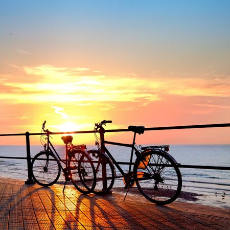 recreational pursuit: Two bicycle silhouette on a sunset. Summer landscape.