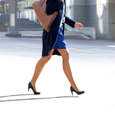 Business woman walking on the background of the office. The modern woman. photo