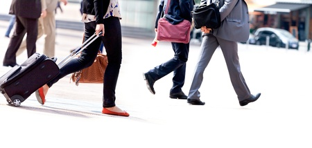 business activity: A large group of people walking. Hurrying passengers.