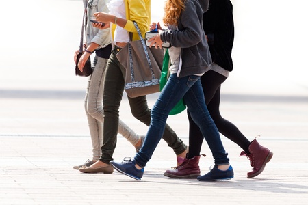 Merry band of teenagers. Urban landscape.