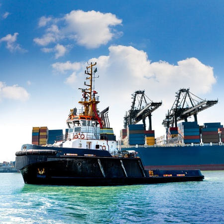 tug boat: Cargo sea port. Sea cargo cranes. Tug.