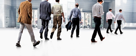 Employees going against the office  Panorama  A group of businessmen  Stock Photo