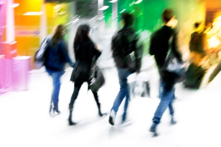striding: A group of young arriving passengers  Motion blur  Stock Photo