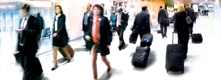 A large group of arriving businessmen  Panorama  Motin blur  Stock Photo