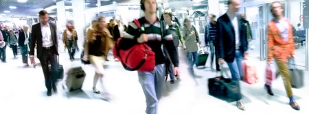A large group of arriving passengers  Panorama  Motion blur