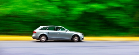 Car in blurred motion on road. Abstract background. Speed.