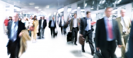 crowded: A large group of arriving businessmen. Panorama. Motin blur.