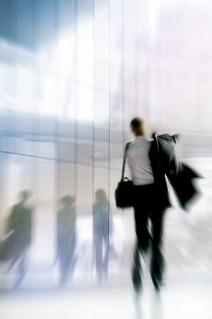 An employee returning to work. Motion blur. Urban scene.