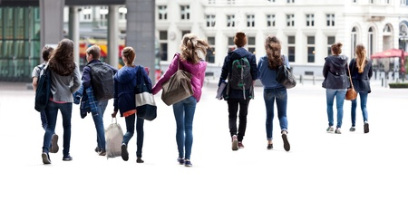 motion: A large group of young people  Urban scene