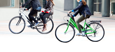 Cyclist on a city street. Urban scene.